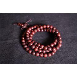 A rosewood Buddha string.
