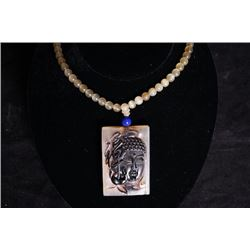 "An Antelope Horn ""Buddha Head"" pendant + beads chain."