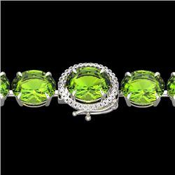 67 CTW Peridot & Micro VS/SI Diamond Halo Designer Bracelet 14K White Gold - REF-428Y8K - 22270