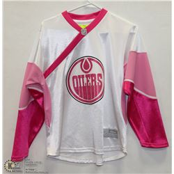 GIRL OILERS JERSEY SIZE 14.
