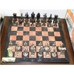 STONE CHESS BOARD WITH ROMAN THEMED PIECES, WITH