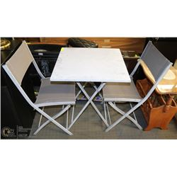 GRAY PATIO TABLE AND TWO FOLDING CHAIRS.