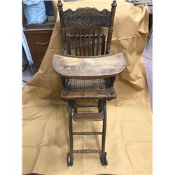 "HIGHCHAIR/STROLLER, PRESSED BACK, LATE 1800s ORIGINAL CAST WHEELS, CANE SEAT, 41"" H"