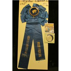 """(1915) Cedar County Fair, Tipton, Iowa First Premium"""" blue Ribbon & a circa 1915 Magic Coin, which a"""