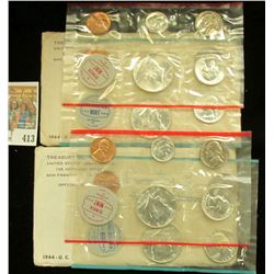 A pair of 1964 P & D U.S. Mint Sets, Original as issued in envelopes and cellophane.