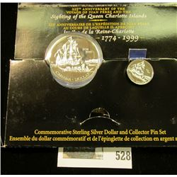 1999 Royal Canadian Mint (RCM) Commemorative silver set, dollar and Collector Pin Set.