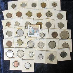 (37) CARDED FOREIGN COIN LOT FROM AROUND THE WORLD