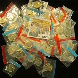 1275 _ (50) 1965-78 U.S Mint Single Roosevelt Dimes in original U.S. Mint Cellophane as cut from Min