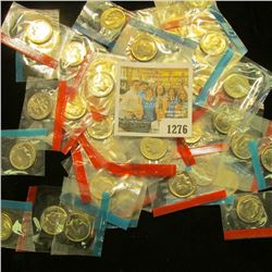 1276 _ (50) 1965-78 U.S Mint Single Roosevelt Dimes in original U.S. Mint Cellophane as cut from Min