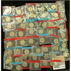 1277 _ (50) 1965-78 U.S Mint Single Roosevelt Dimes in original U.S. Mint Cellophane as cut from Min