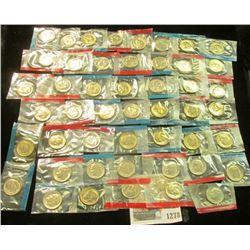 1278 _ (50) 1965-78 U.S Mint Single Roosevelt Dimes in original U.S. Mint Cellophane as cut from Min