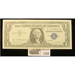 1556 _ Series 1957B $1 U.S. Silver Certificate. Near Crisp Unc. Small centralized rust spot.