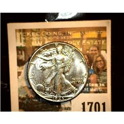 1701 _ 1943 P Walking Liberty Half Dollar, consignor had graded GEM BU 65. Have a good look and if y
