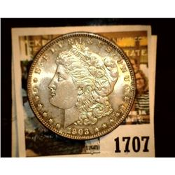 1707 _ 1903 P U.S. Silver Morgan Dollar, Choice BU 63. Gold toning.