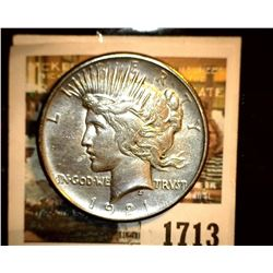 1713 _ 1921 P U.S. Silver Peace Dollar, Choice VF. Small obverse planchet defect. Gold toning.