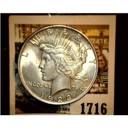 1716 _ 1923 P U.S. Silver Peace Dollar, Choice BU 64. Gold toning.