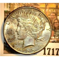 1717 _ 1925 P U.S. Silver Peace Dollar, Choice BU 64. Gold toning.