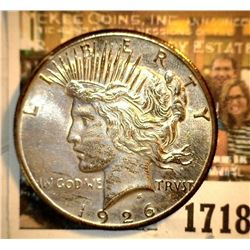 1718 _ 1926 P U.S. Silver Peace Dollar, Choice BU 64. Gold toning.