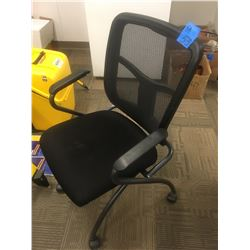 2 Black mesh office chairs on wheels