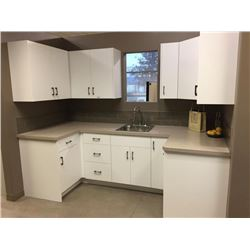 NEW white 18 door Kitchen Cabinet Display. Includes all cabinets, molding, counter tops, plumbing fi