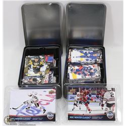 2 TINS OF ASSORTED HOCKEY CARDS.