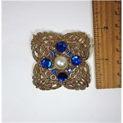 10)  GOLD TONE FILAGREE BROOCH WITH