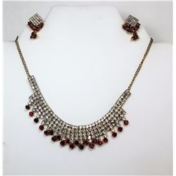 11)  GOLD TONE WITH RED & CLEAR CRYSTAL