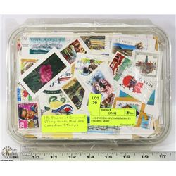 1-1/2 POUNDS OF COMMEMORATE STAMPS - MOST