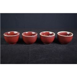 A set of four export sacrificial red glaze cups.