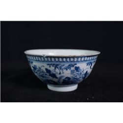"A small blue-and-white ""birds and flowers"" bowl"