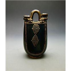 A Black Stoneware Flask; waterskin shape.