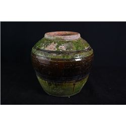 Qing Dynasty, a green glaze jar.