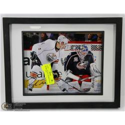 106) TAYLOR HALL FRAMED SIGNED PICTURE, NOT