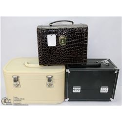 2 LEATHERETTE TRAIN CASES WITH KEYS, ONE IS