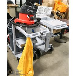 TWO CLEANING CARTS SOLD WITH HENRY VAC