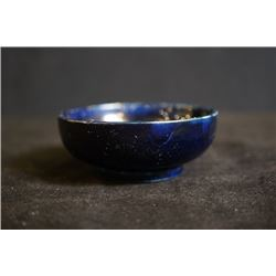 "A small ""Flowers"" cobalt blue teacup."