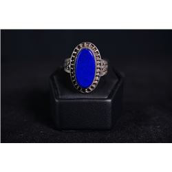 A silver ring inlaid with Lapis Lazuli.