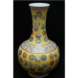 A small Famille rose globular vase with gold details.