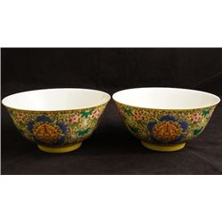 A pair of yellow ground famille rose bowls.