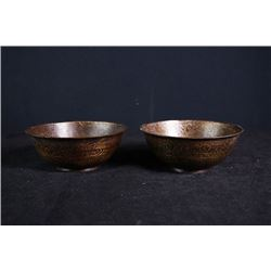 "Two cooper bowls engraved with ""Figures and Flora""."