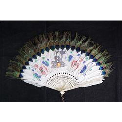 "A feather fan with ""lady"" pattern."