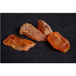 Four Amber raw gemstones.