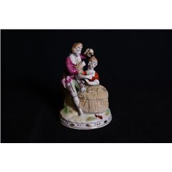 A Europe Famille-Rose porcelain figurine.