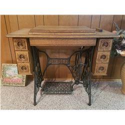 Singer sewing machine in oak cabinet, very nice