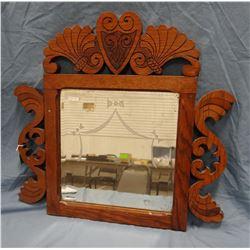"Beveled mirror in oak frame, 23"" x 24"""