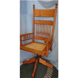 Oak swivel office chair, caned seat