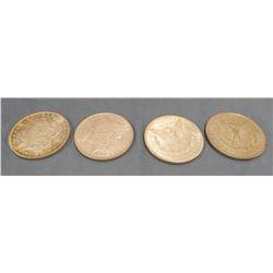 4 Morgan dollars - 1899-O, 1886, 1902-O, 1921D