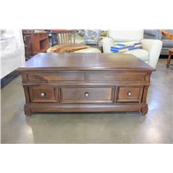 ASHLEY FLOOR MODEL LIFT TOP COFFEE TABLE WITH 3 STORAGE DRAWERS, LIGHT FINISH RETAIL $1399