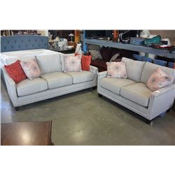 NEW ASHLEY CONTEMPORARY TAN FABRIC SOFA AND LOVESEAT WITH BRASS NAILHEAD AND 6 THROW PILLOWS RETAIL