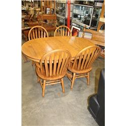 ROUND OAK DINING TABLE W/ LEAF AND 4 CHAIRS